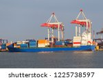 a large large cargo ship enters ... | Shutterstock . vector #1225738597
