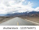 wild field highway  | Shutterstock . vector #1225760071