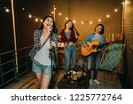band playing music practicing... | Shutterstock . vector #1225772764
