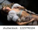 blonde in underwear and fur... | Shutterstock . vector #1225790104