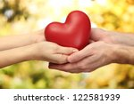 red heart in woman and man... | Shutterstock . vector #122581939