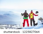 two snowboarders stands on... | Shutterstock . vector #1225827064