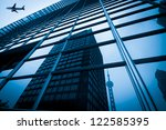 modern blue glass wall of... | Shutterstock . vector #122585395