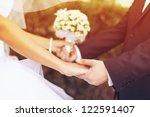 Stock photo wedding couple holding hands 122591407