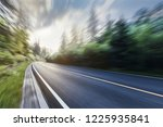 the highway is in green forest. | Shutterstock . vector #1225935841