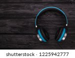 blue headphone on black wooden... | Shutterstock . vector #1225942777
