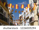 spanish flags on the street in... | Shutterstock . vector #1226035294