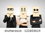 Stock photo men and woman with smiling box on head 122603614