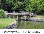 scenery of wooden bridge over... | Shutterstock . vector #1226103367