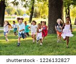 a group of happy children of... | Shutterstock . vector #1226132827