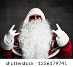 santa claus pointing hands up... | Shutterstock . vector #1226179741