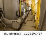 pumping unit and piping under... | Shutterstock . vector #1226191417