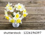 white daffodils at china vase... | Shutterstock . vector #1226196397