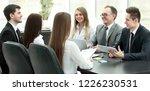 business team holds a workshop... | Shutterstock . vector #1226230531
