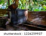 indigenous preparing hot water... | Shutterstock . vector #1226259937