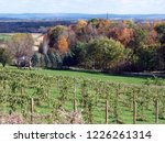 Scenic landscape near Baraboo, WI - with winery, forest in fall colors, agricultural fields and Baraboo hills in the distance. Taken in October.