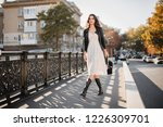 young stylish woman walking in... | Shutterstock . vector #1226309701