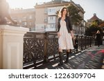 young stylish woman walking in... | Shutterstock . vector #1226309704