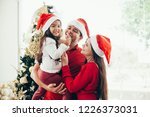 young family celebrating... | Shutterstock . vector #1226373031