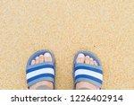 man's feet wear gray and white...   Shutterstock . vector #1226402914