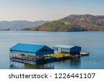 covered floating boat dock in... | Shutterstock . vector #1226441107