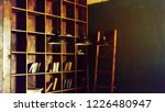 library. bookshelves with... | Shutterstock . vector #1226480947
