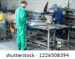 black smith welding pieces of... | Shutterstock . vector #1226508394