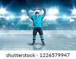 hockey player raised his hands... | Shutterstock . vector #1226579947