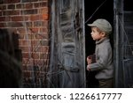 the little boy is playing hide... | Shutterstock . vector #1226617777