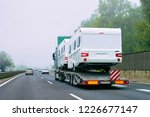 truck carrier with motor homes... | Shutterstock . vector #1226677147