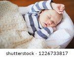 adorable baby girl sleeping in... | Shutterstock . vector #1226733817