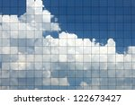clouds reflected in windows of... | Shutterstock . vector #122673427