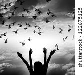 Silhouette of girl and flying dove on sky background, freedom and peace concept black and white - stock photo