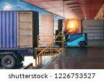 Forklift Handling Empty Tin...