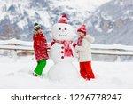 child building snowman. kids... | Shutterstock . vector #1226778247