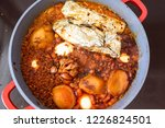 pot of spicy meat cooked with... | Shutterstock . vector #1226824501