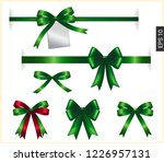 green ribbon bow with tag... | Shutterstock .eps vector #1226957131