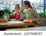 two teenage students sitting in ... | Shutterstock . vector #1227008257
