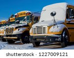 A Row Of School Buses After A...