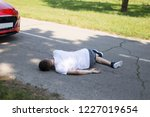 injured man laying on the...   Shutterstock . vector #1227019654