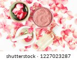 Stock photo top view botanical skincare home spa treatment with pink petals rose blossom clay face mask 1227023287