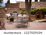 cafe. small patio. tables and... | Shutterstock . vector #1227029104