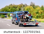 mini van with motorcycles on... | Shutterstock . vector #1227031561