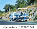 rv car with motor boat in road. ... | Shutterstock . vector #1227031564