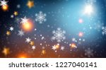 blue sparkling background with... | Shutterstock . vector #1227040141
