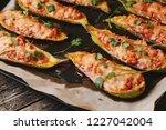 baked stuffed zucchini boats.... | Shutterstock . vector #1227042004