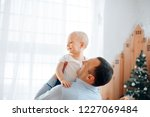 happy father with child  is...   Shutterstock . vector #1227069484