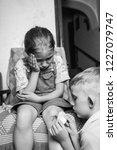 a little girl hurt her knee  a... | Shutterstock . vector #1227079747