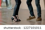 man and woman are dancing. feet ... | Shutterstock . vector #1227101011