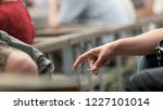 hand of young person holding... | Shutterstock . vector #1227101014